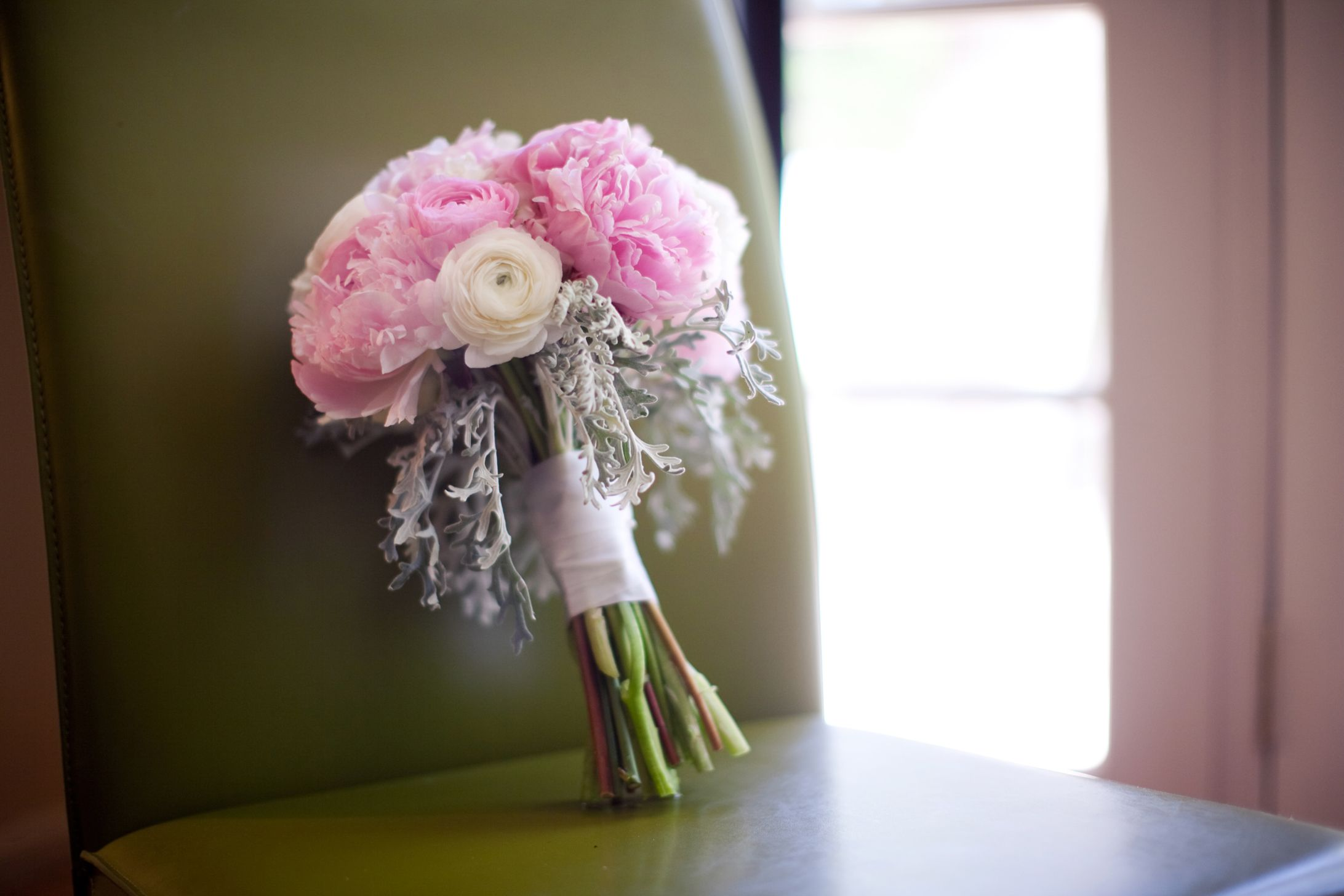 Pink peonies and ranunculus with a dusty miller collar. #FlowersPhoenix #PinkBridalBouquet