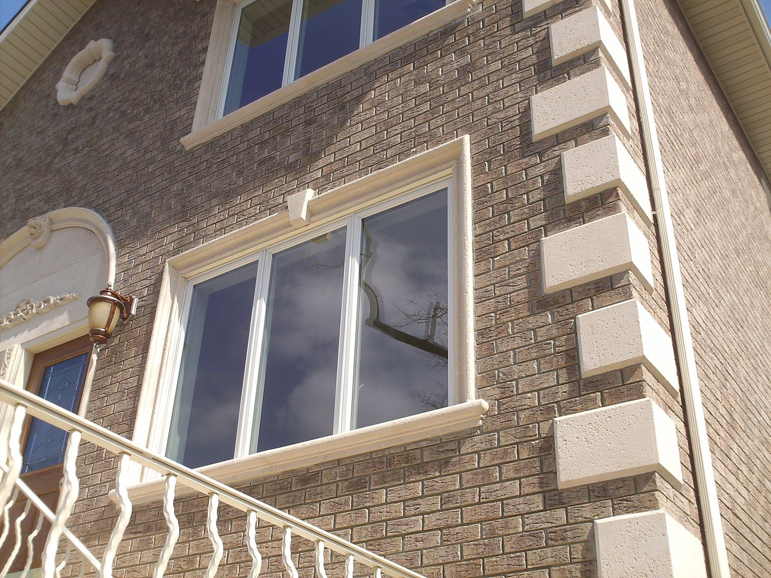 Home with precast concrete window surrounds quoins and for Brick quoins
