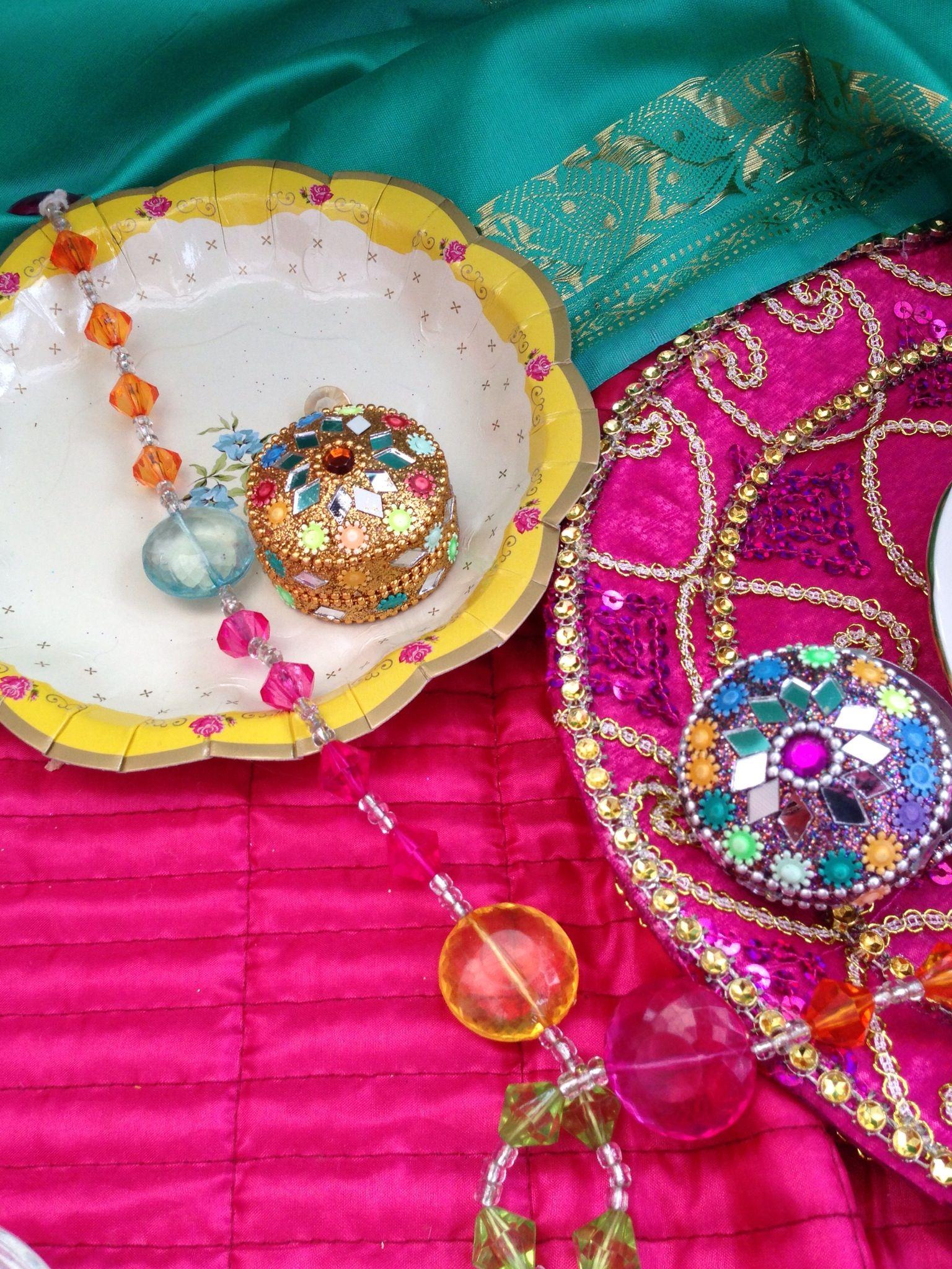 Stunning gemstone trinket favour boxes displayed on vintage plates ...