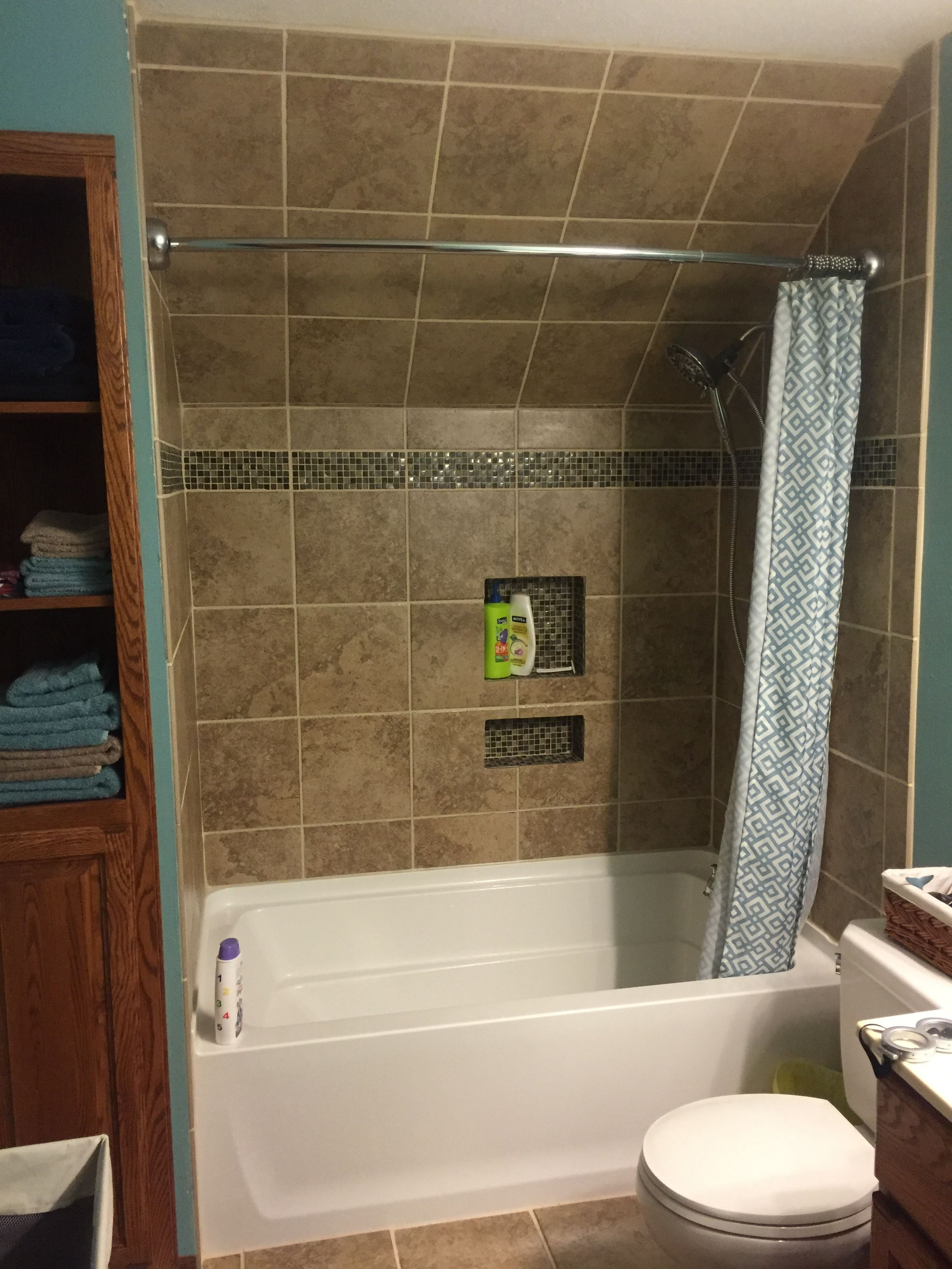 Upstairs Bathroom With Slanted Or Sloped Ceilings
