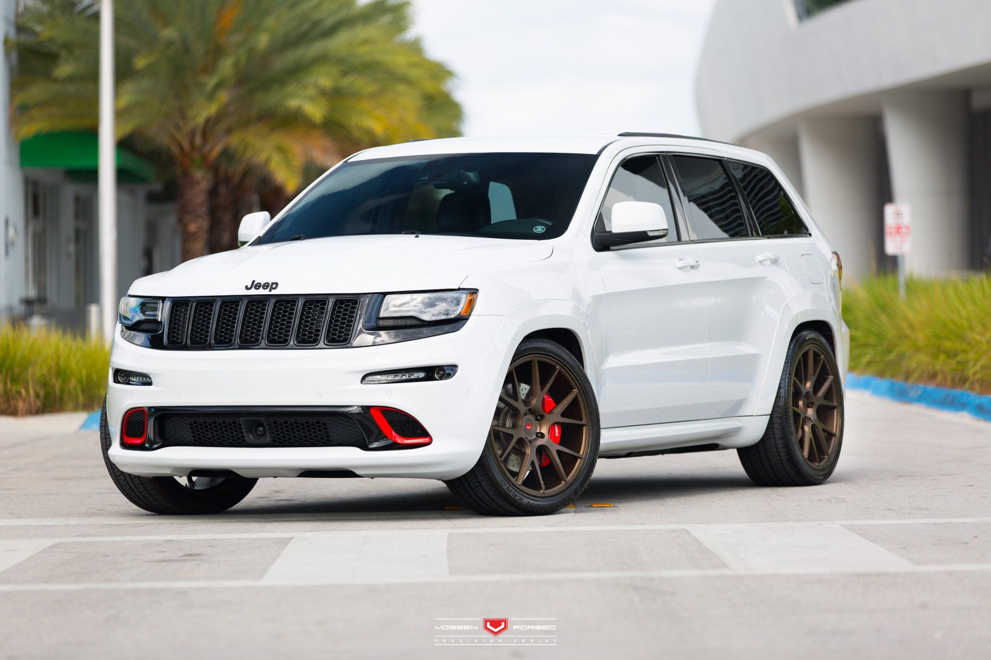 Custom Jeep Grand Cherokee With Red Accents And Vossen Wheels Jeep Srt8 Jeep Cars Jeep Grand Cherokee Srt