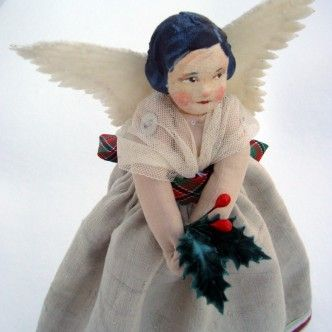 @Marcelle Kimberley - A handmade Christmas tree fairy, with a hand painted face, made from vintage materials.