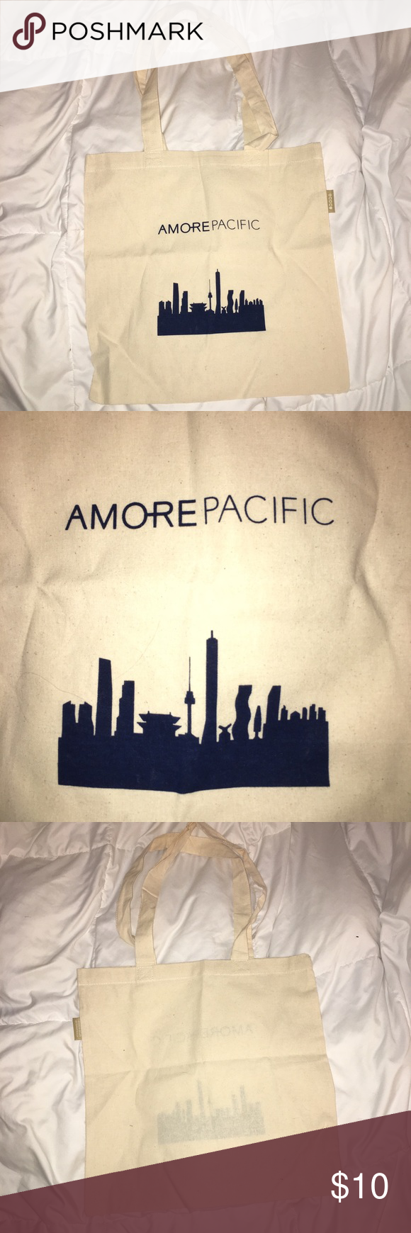 Amore Pacific canvas tote bag Amore Pacific canvas tote bag💙small canvas tote, perfect for items that you wouldn't want to get your regular purse dirty! Has some fabric piling but not noticeable. Amore Pacific Bags Totes