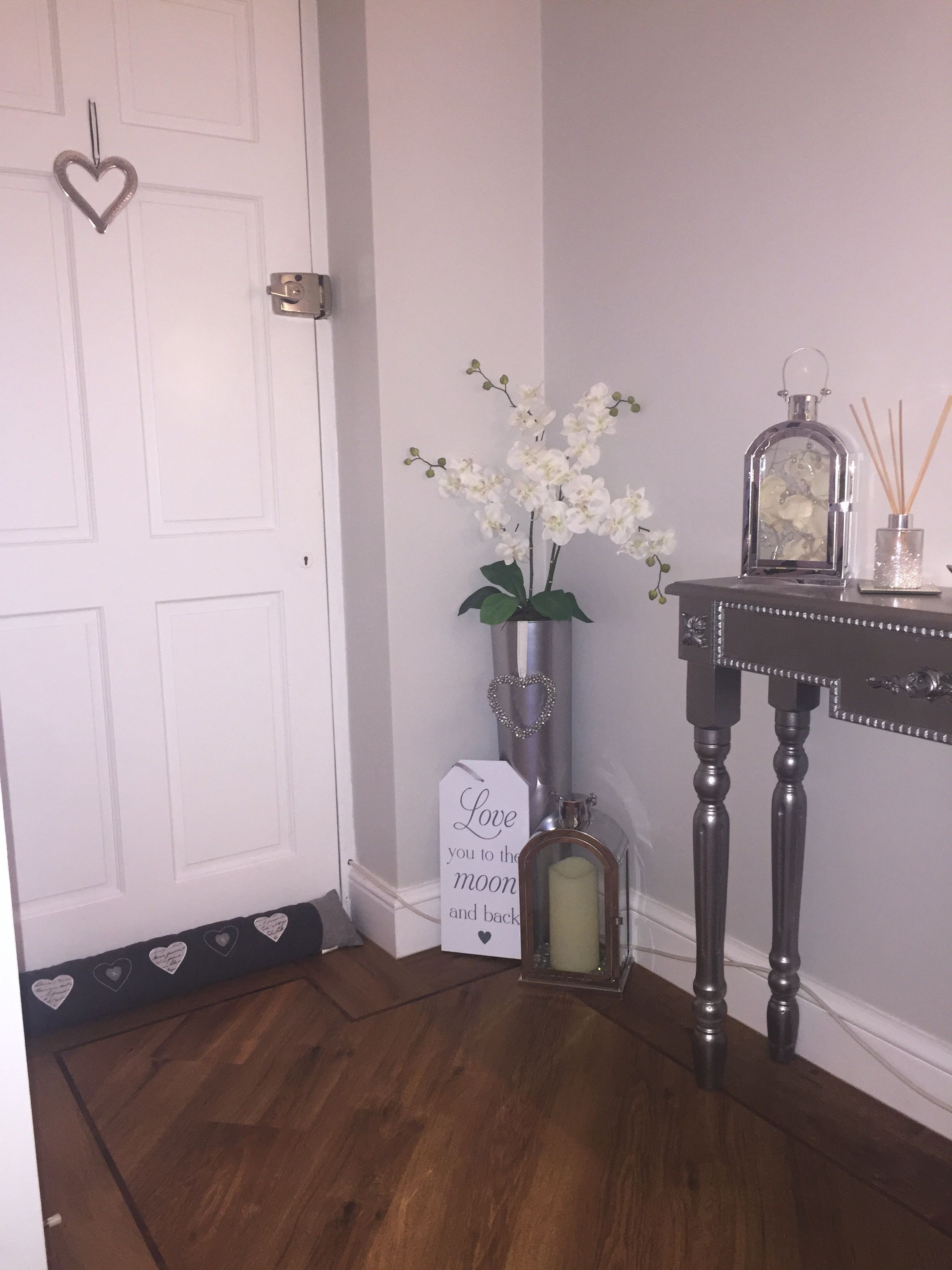 Tall Floor Vase That S Been Spayed Chrome With Orchid Arrangement Chrome Lantern In Different Sizes Adding Some Det Floor Decor Floor Lanterns Diy Home Decor