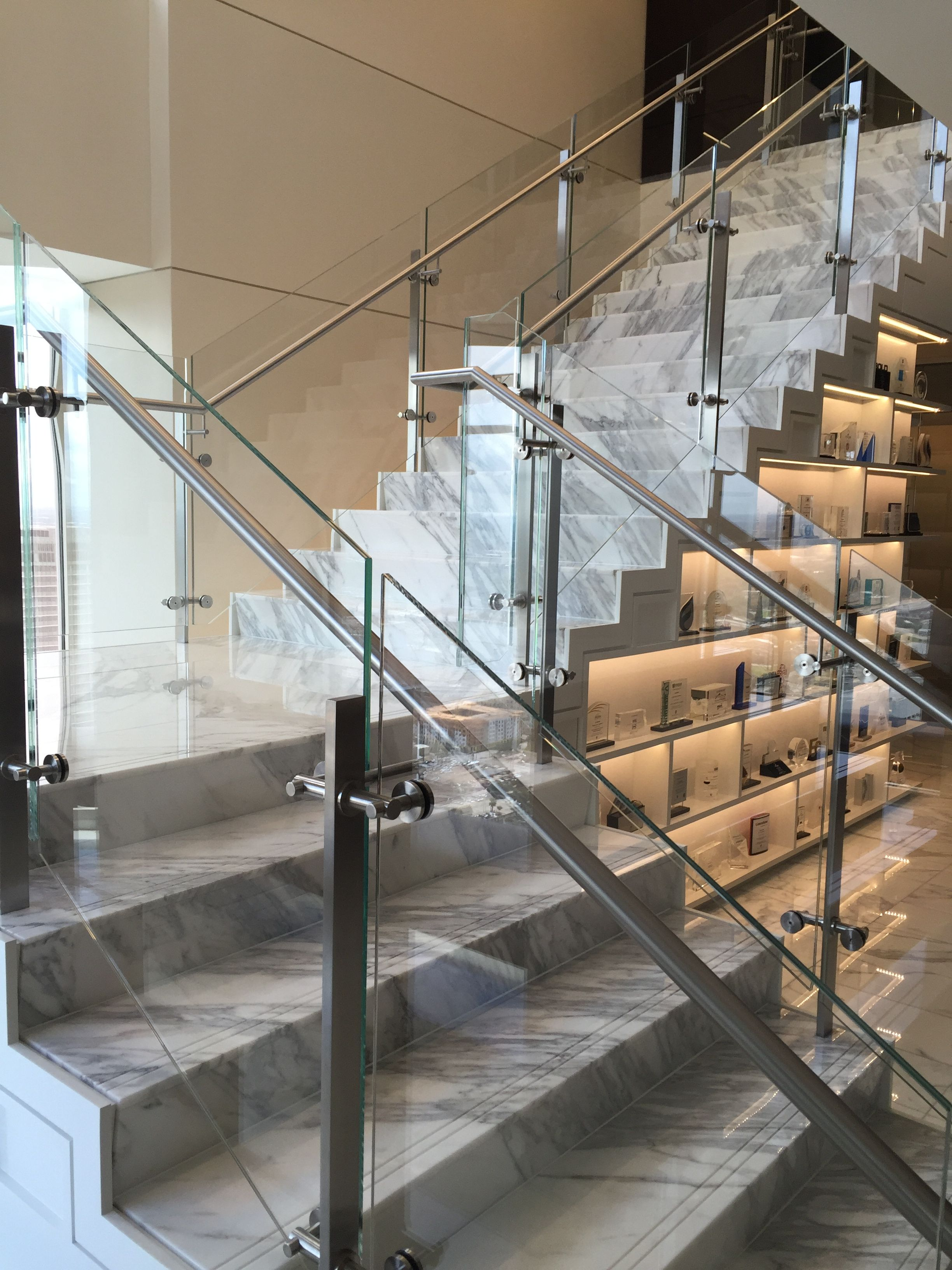 Glass Railing With Stainless Steel Glass Clamps Stairs Design | Stair Railing Design Modern With Glass | L Shape | Interior Residential Metal | Simplistic | Grill | Button Glass