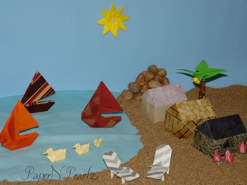 Its hot, hot, hot here!! So thought of sharing my very first #origami #composition - An Origami #Summer 🏖️🏖️  #origamipaper #paperart #origamilove #papernpearlz #origamiart #origamiindia #catamaran #beachchairs #duck #house #tree