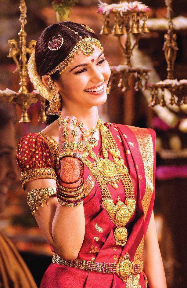 Traditional Southern Indian bride wearing bridal silk saree ...