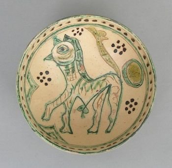 "A Nishapur Glazed Bowl with Bird-Horse Figure, Persian, ca. 10th/12th Century  Round footed bowl with interior decoration in three colors, depicting a horse with a bird's head, hmm. Very interesting, approx. 2-7/8""T x 6-5/8"" in diameter."