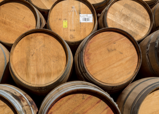 Whole Wine Barrels Stacked In The Pyramid At Real Wood Products Wine Barrel Barrel Real Wood