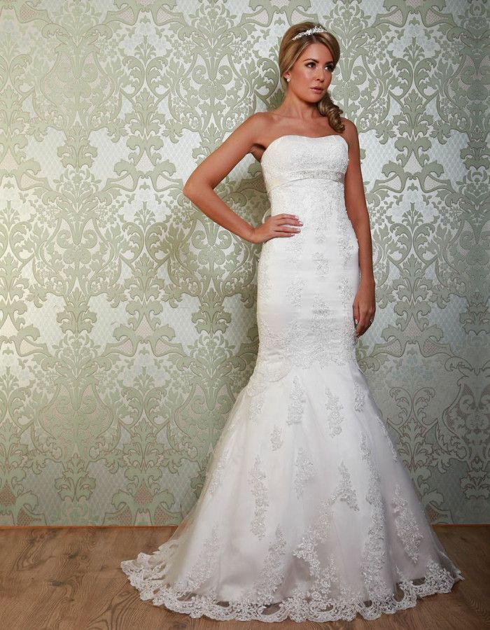 CLOVER A stunning fishtail gown with pretty sash detail under the bust. The lace overlay of the gown also forms a sweeping train. https://www.wed2b.co.uk/vintage-wedding-dresses/viva-bride-clover.php