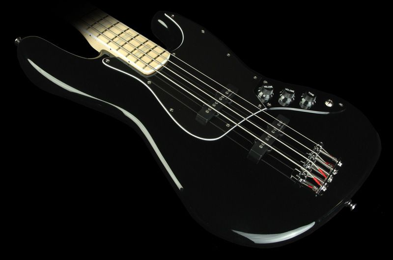 Vintage Modified Jazz Bass 77 Squier S Vintage Modified Jazz Bass 77 Returns You To The Age Of Funk And The Dawn Of Punk Squier Squier Guitars Tinted Gloss