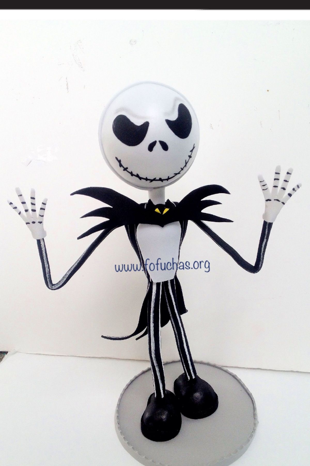 Jack Skellington Fofucho doll. He is handmade using foam sheets. He stands 11 inches. He would be a great collection piece. To purchase visit fofuchas.org or like us at facebook.com/fofuchashandmadedolls #JackSkellington #foam dolls #crafts