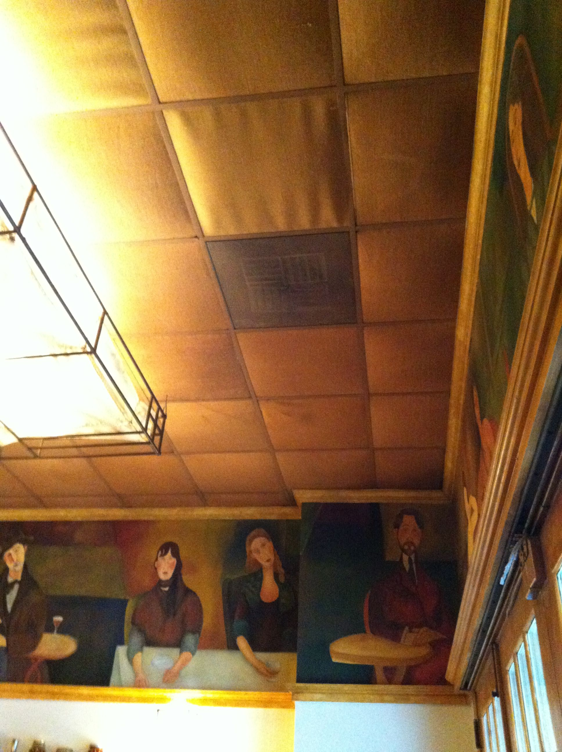 Drop ceiling in a restaurant in FL hang cloth instead of those