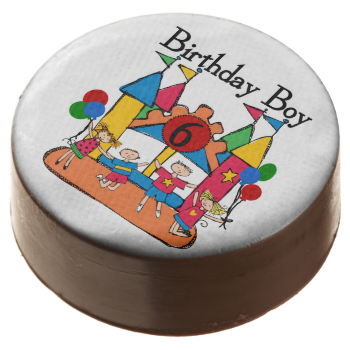 Bounce House Birthday Boy 6th Birthday dipped Oreos and Oreo pops, a sweet treat for the birthday boy and the guests at the celebration, also makes a fantastic take home party favor! Features several children having fun on a bounce house, balloons, a number 6, and text that reads Birthday Boy! #kids #birthdays #boys #birthday #boy #bouce #house #bouncy #amusement #park #6th #birthday #sixth #birthday #six #cute