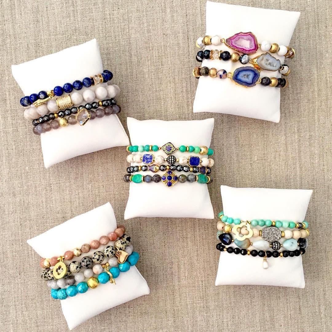 Pretty boho bracelet display on white pillows.