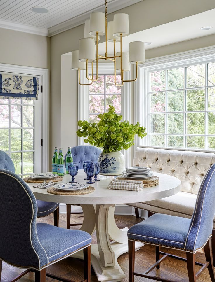 Blue and white breakfast table with upholstered banquette ...