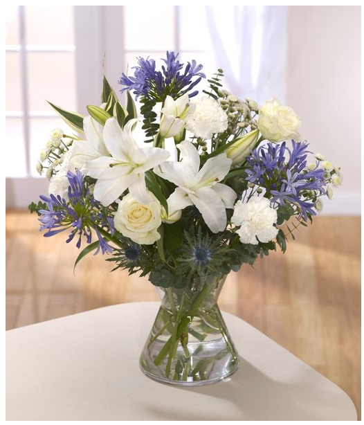 White Lily And Agapanthus Table Arrangement Flower Arrangements Flower Delivery Same Day Flower Delivery