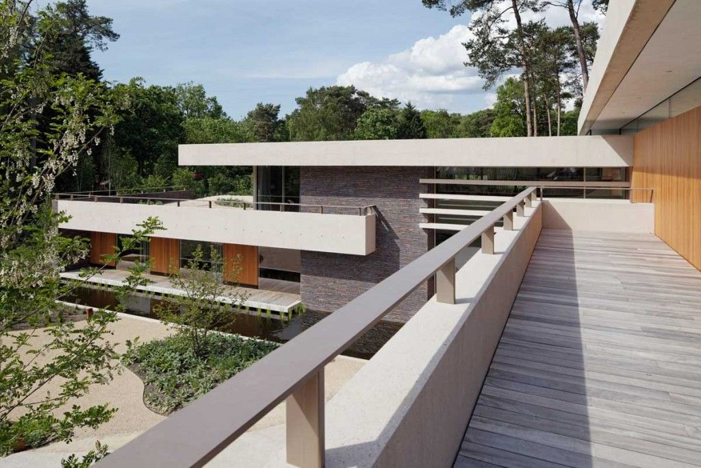 Accessories: Second Floor Balcony Frank Loyd Wright Mies Van Der Rohe And Zumthor Hilberinkbosch Architects Fully Embrace Those Lovely Natural Surroundings Wood Floring Area Black Stone Decorations Beautiful Forest View: The Outer Of This House Companion Its Awesome Natural Environment