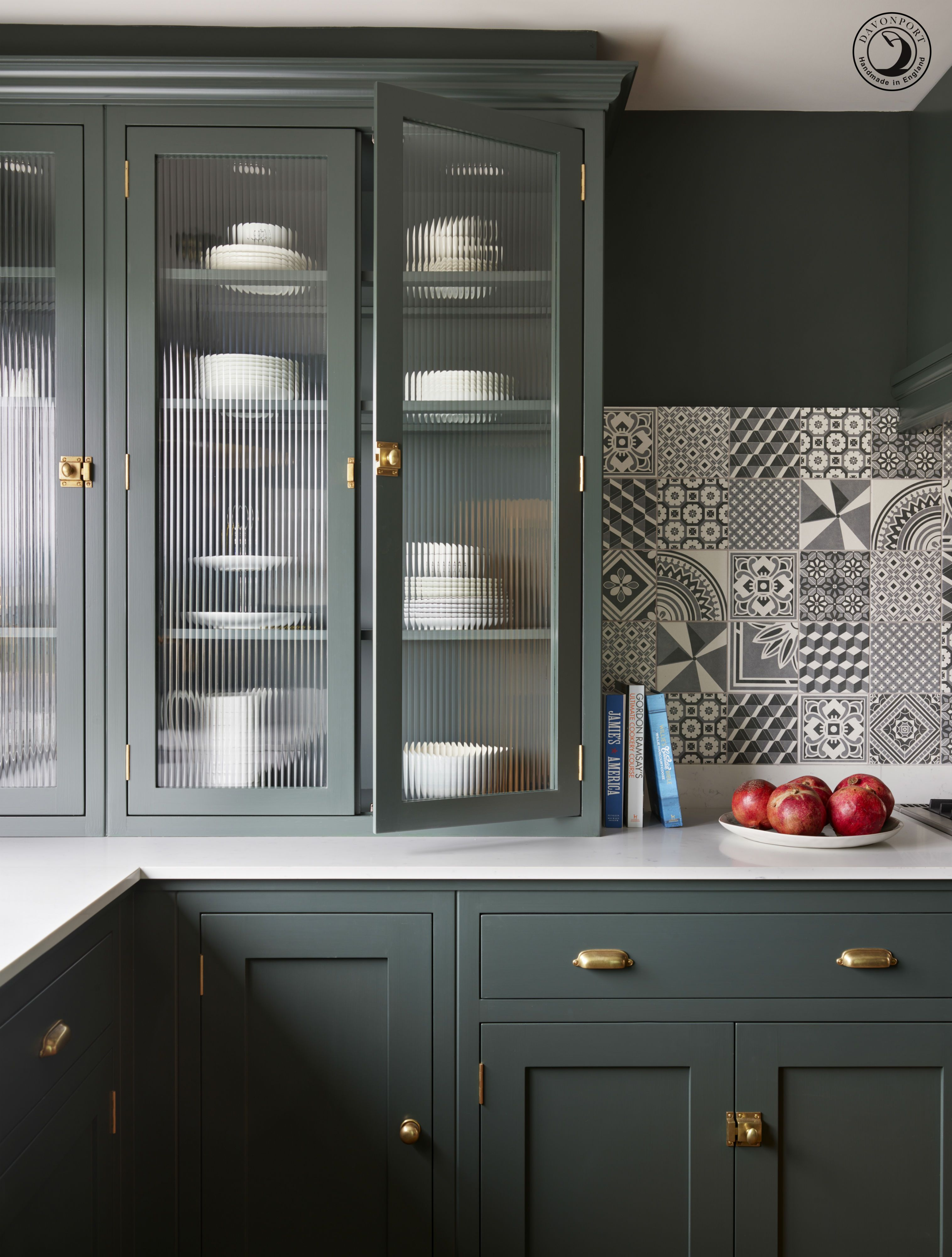 The Countertop Cupboards With Fluted Glass And On Trend Brass Catches Are The Perfect Place Green Kitchen Cabinets Urban Kitchen Design Glass Kitchen Cabinets