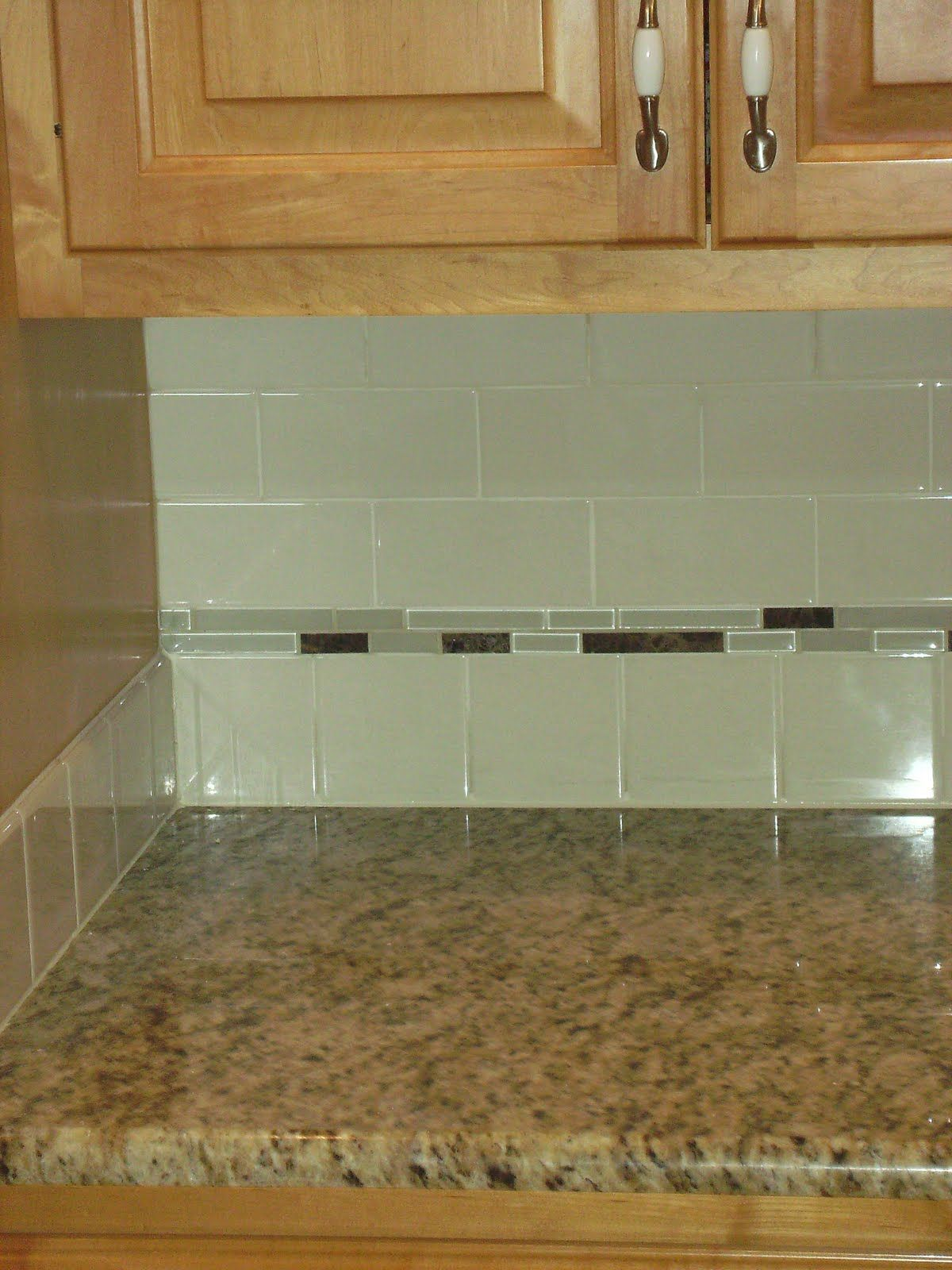 Green glass subway tiles with small grey glass accent for Glass tile kitchen backsplash ideas