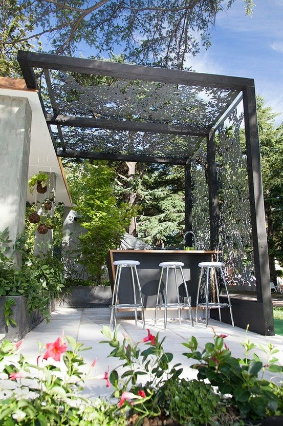 overhead shade structure  outdoor bar with decorative  detailed iron pattern