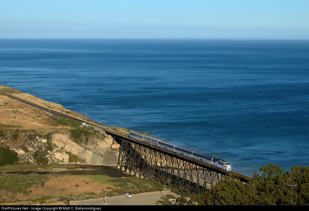 Amtraks northbound Pacific Surflinerer to San Luis Obispo crosses over the Gaviota Trestle on a beautiful summer evening.