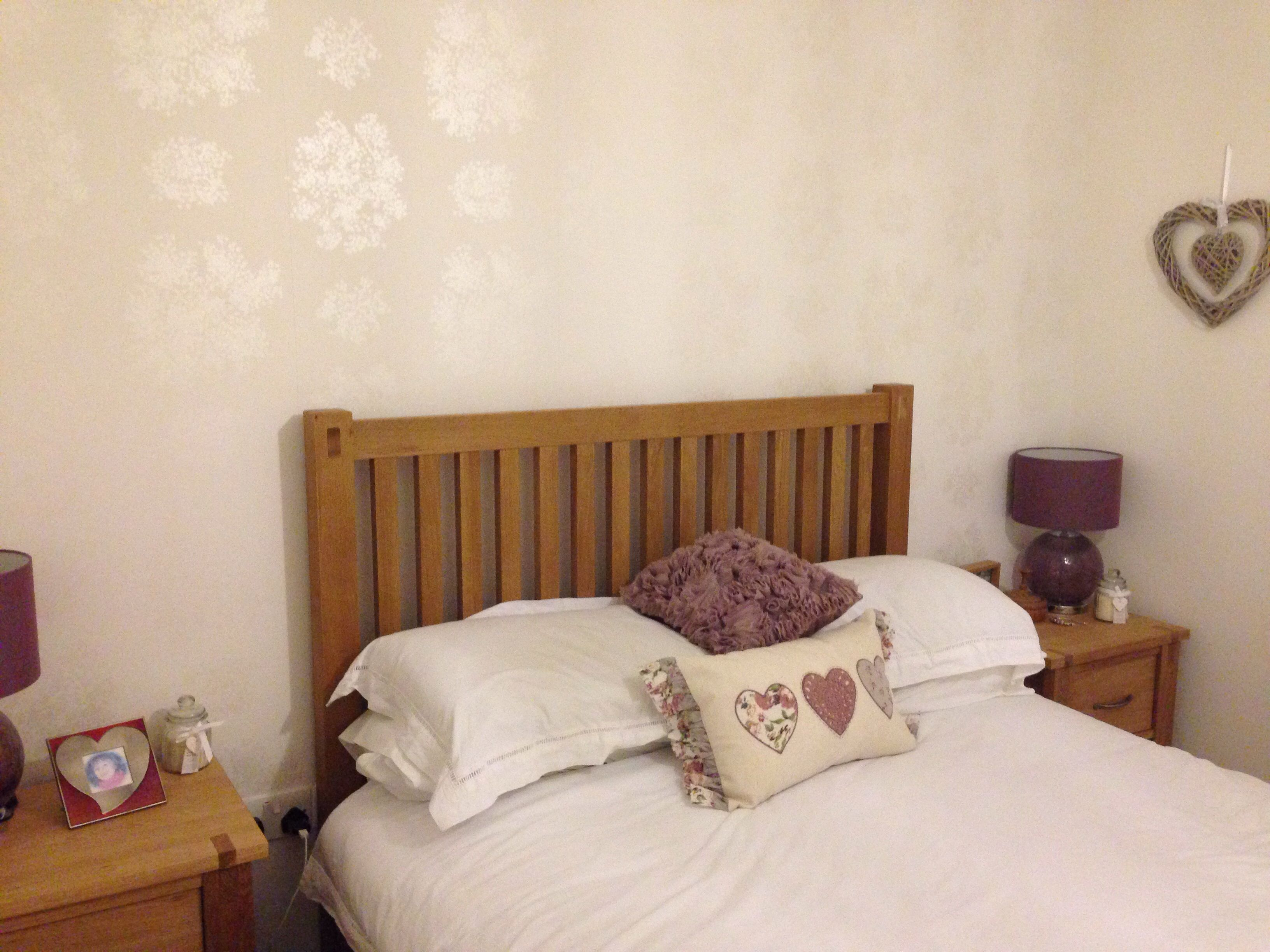 White bedroom with oak bed and gypsophila wallpaper by laura ...