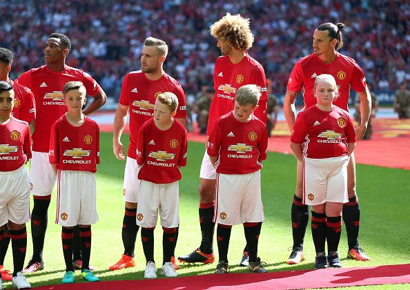 Manchester United players stand in line prior to kick off during The FA Community Shield match between Leicester City and Manchester United at...
