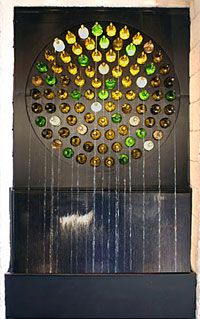 This Copper And Glass Bottle Water Feature At Javier S Cantina Was Designed By Sean So Of Water Studio Bottle Wall Bottle House Wine Bottle Art