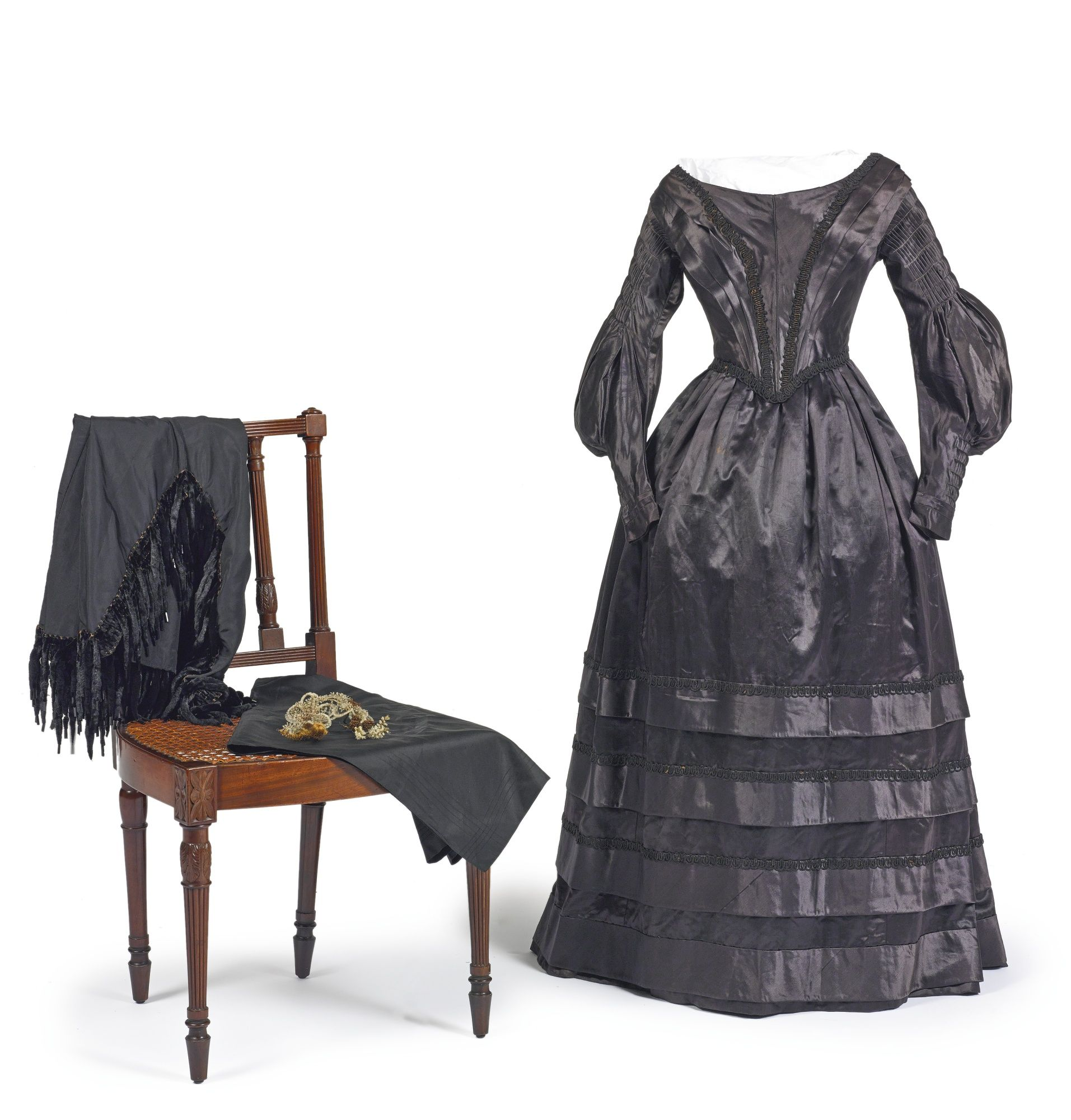 Group of mourning clothes consisting of a woman\'s black silk satin ...