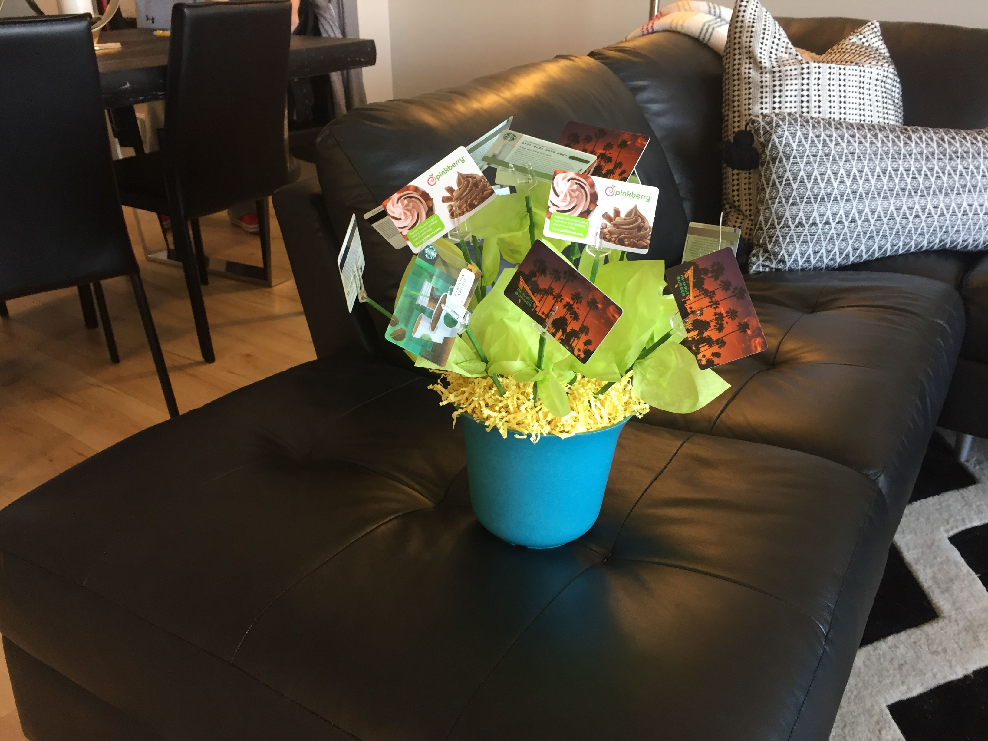 Make a bouquet of gift cards to leave as a thank you to