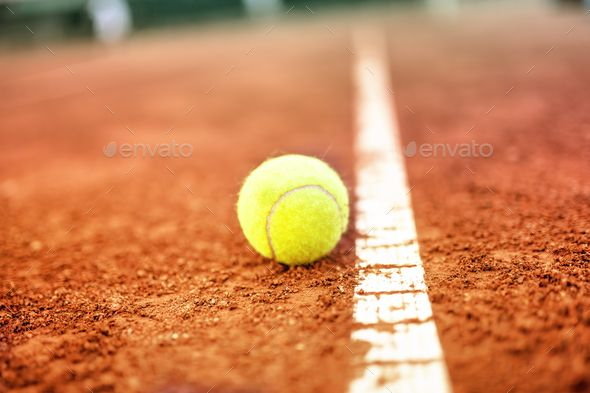 Tennis Ball On A Tennis Clay Court By Stockcentral Tennis Ball On