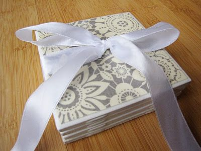 cute coasters made from inexpensive tiles, craft paper, mod podge, and cabinet door stops...cute!