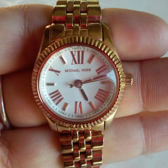 Michael Kors ladies watch Good  working condition I took it to a jewelry store here in town they opened it and told me it's AUTHENTIC. I have no box or no extra links. Its small Michael Kors Jewelry