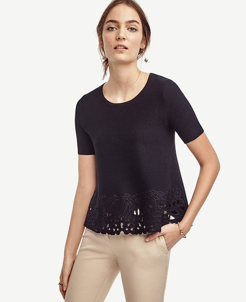 """Make+the+cut:+beautifully+embroidered+floral+cutouts+intrigue+this+pretty+piece+for+a+definitive+wear-now+look.+Jewel+neck.+Short+sleeves.+23""""+long."""
