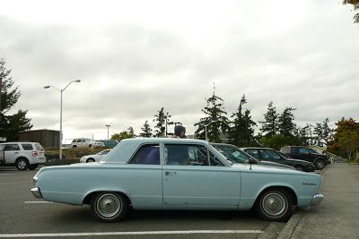 OLD PARKED CARS.: 1966 Plymouth Valiant 100.