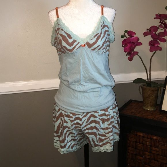 Baby doll pajama set Super cute and comfy. Playful short shorts with matching Cami in adorable baby blue with been tiger stripes. Contrasting orange ribbon detailing. Adjustable straps. Drawstring missing from shorts. PJ Salvage Intimates & Sleepwear Pajamas