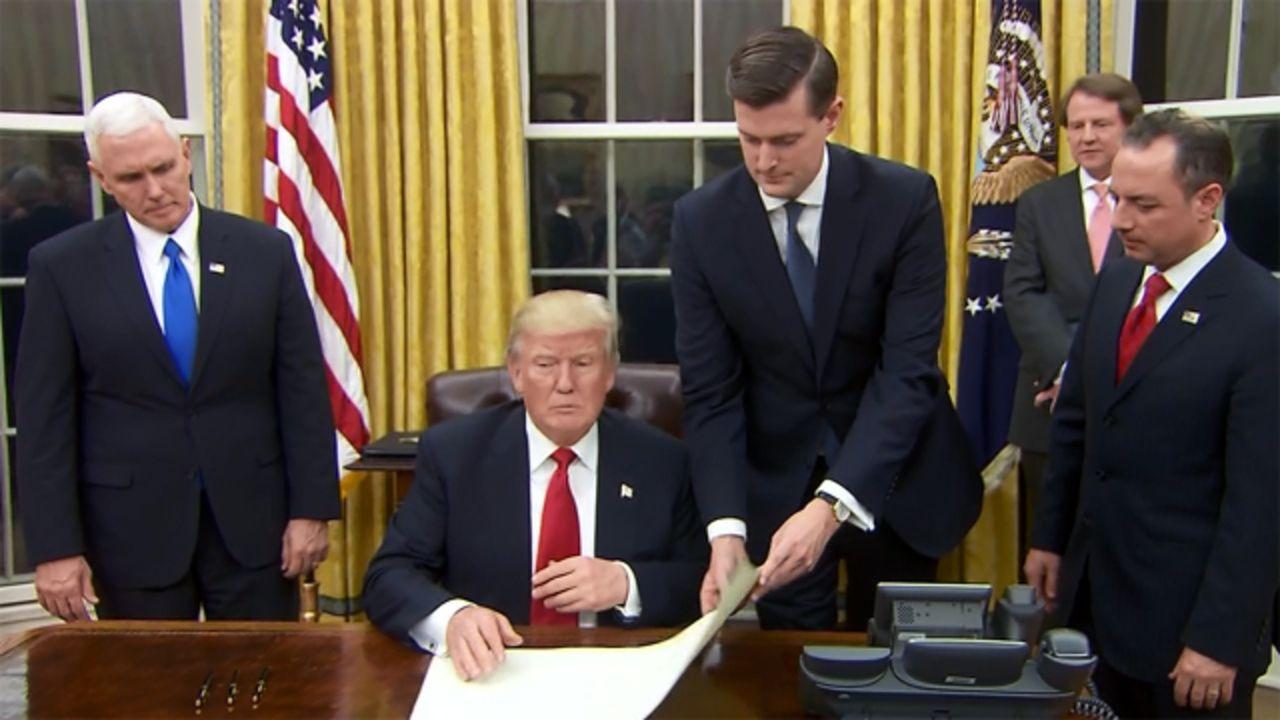 Supreme Court reinstates Trump travel ban Trump sign
