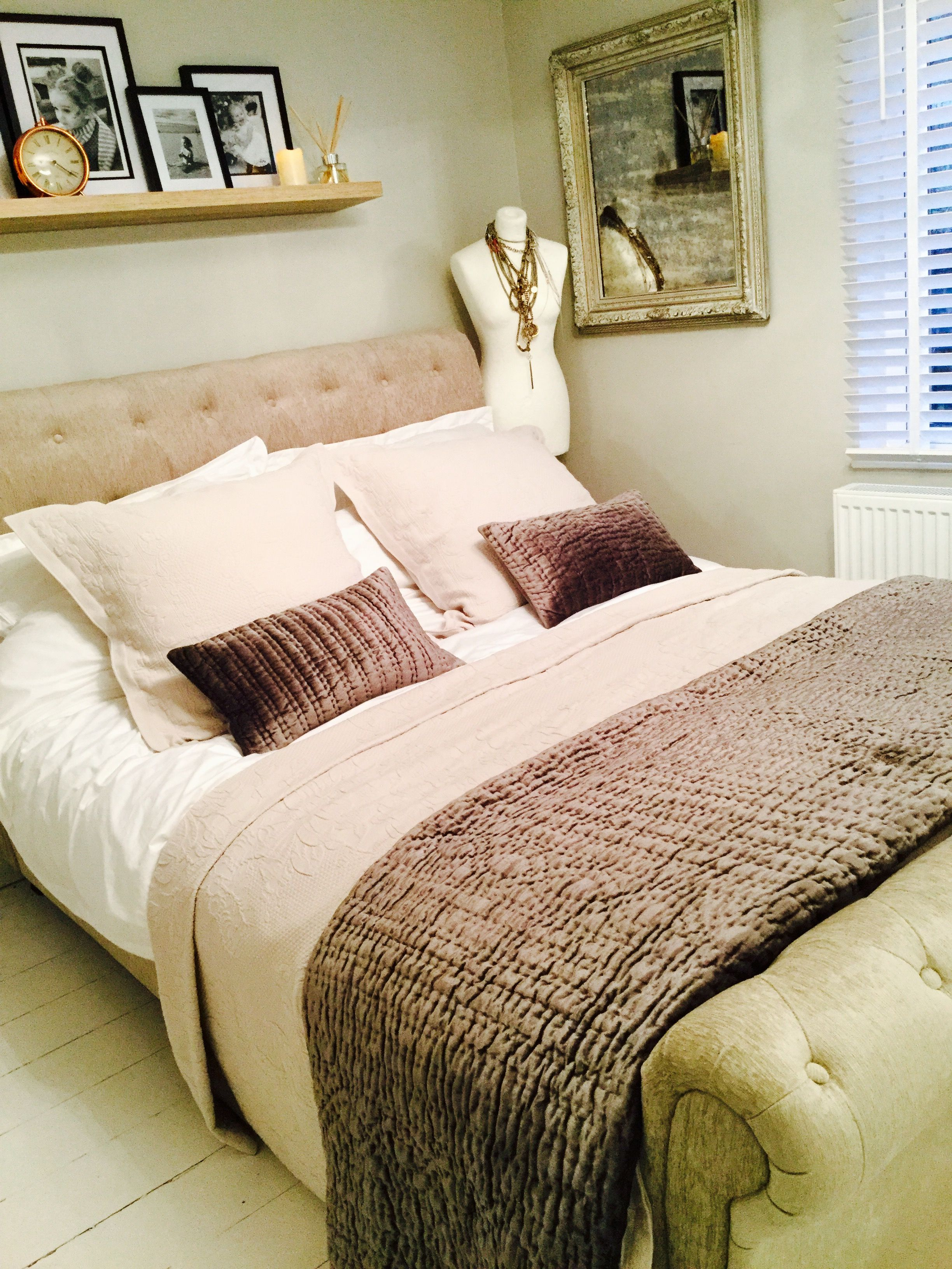 White company bedspread and cushions, distressed mirror