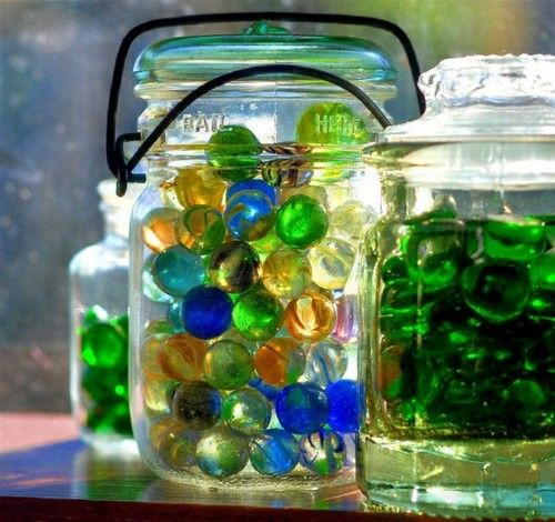 I have marbles in jars in my kitchen window!