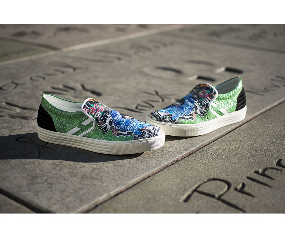#HoganRebel R206 in an original interpretation of men's sneaker combining bright colours and designs reminiscent of oriental tattoos. For a strong personality.
