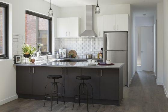 grey spice doors and sour cream doors with enoki benchtops and subway tile splashba kitchen on kaboodle kitchen enoki id=52435