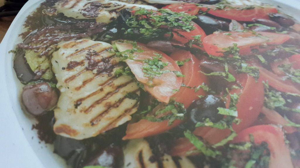 HALOUMI IS A CYPRIOT CHEESE traditionally made from a combination of goat's and ewe's milk. However, many commercial varieties now include cow's milk, which produces an infenor cheese. Oo try to get hold of an authentic haloumi – the flavour and texture will make all the difference to this lovely salad. If you have any olive dressing left over, keep it in a jar in the fridge to use for drizzling over grilled fish or lamb.