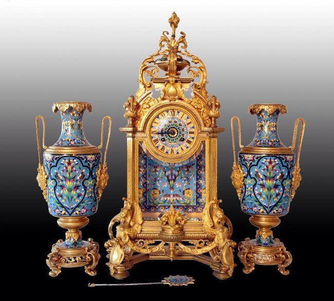 """A n imposing gilt bronze and CHampleve enamel clock set, attributed to F. BARBEDIENNE , Clock 21.5"""" high , vases 16.5"""" high, in perfect condition."""