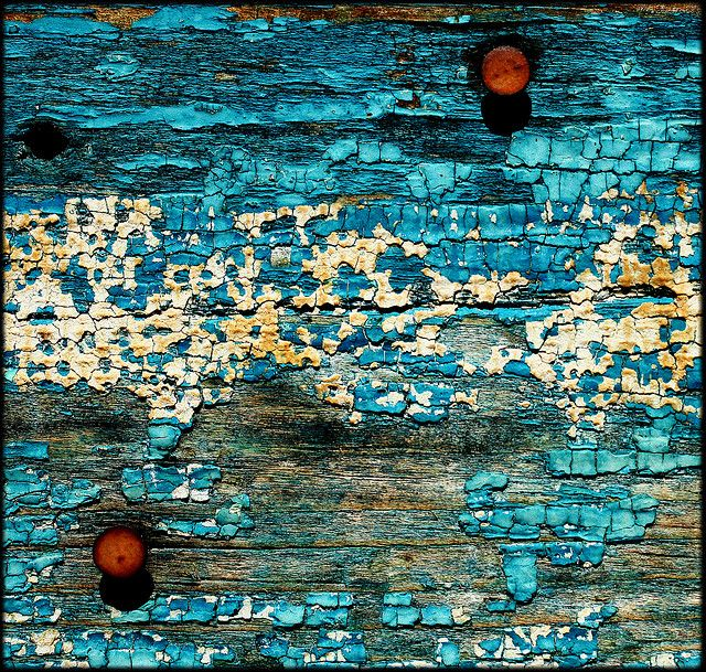 blue paint, rusted nails