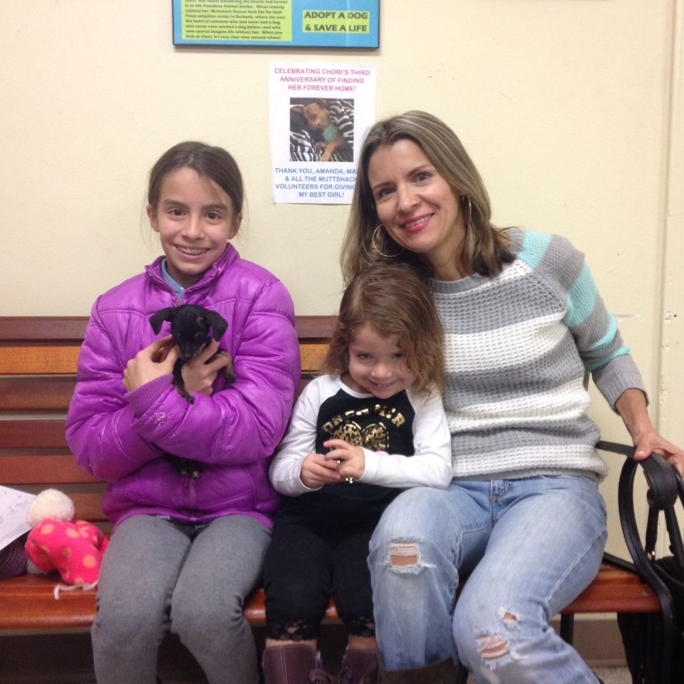 Pixie the pup scored when the Gamez family came for her.  With two lovely sisters to fuss over her she hit the jackpot for the new year. Congratulations.