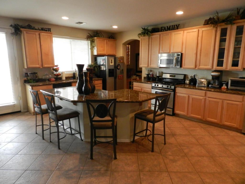 large kitchen with island and tile floors through out