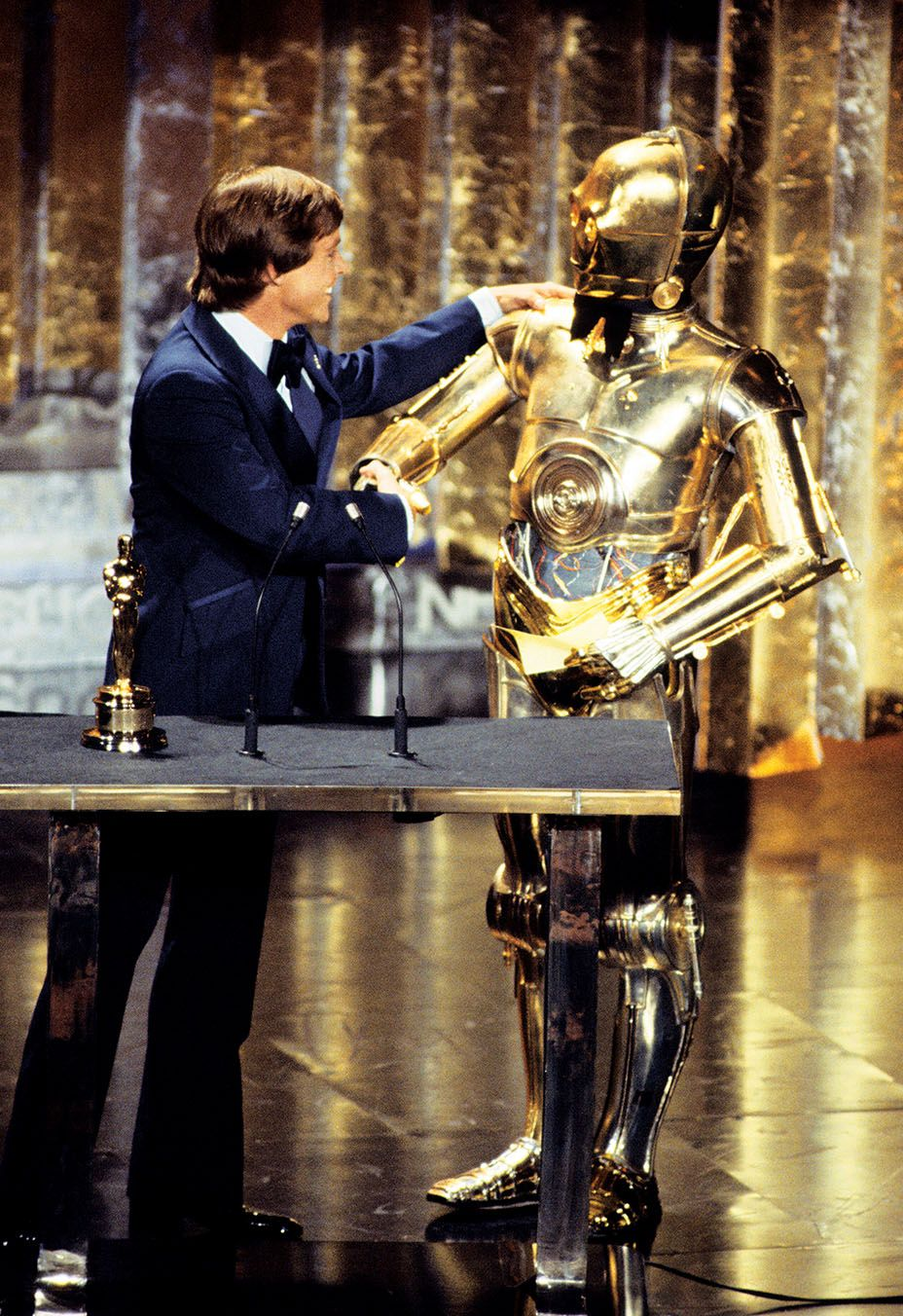 Mark Hamill and C-3PO at the 50th Academy Awards accepting one of seven Oscars Star Wars won that night.