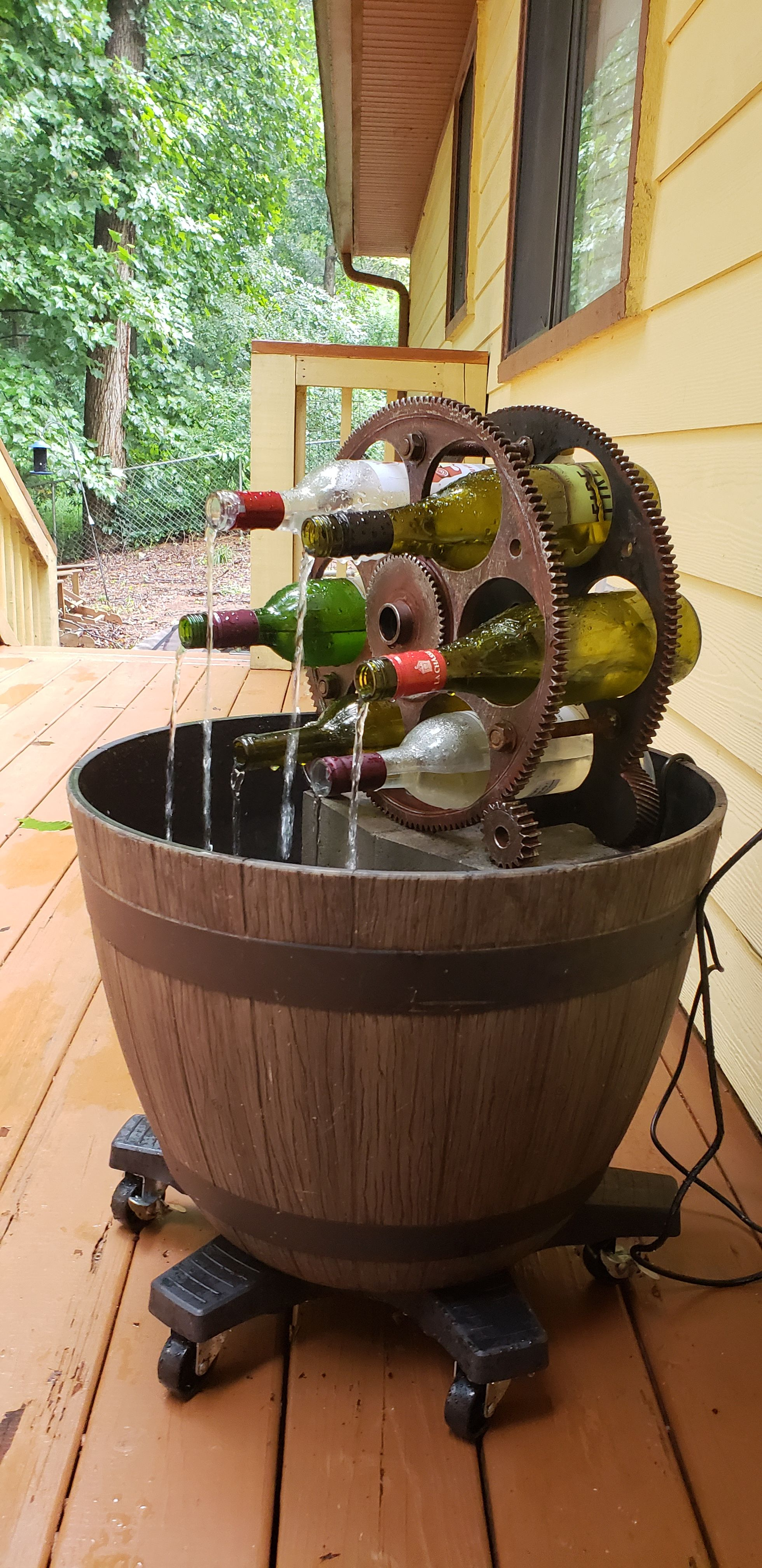 Diy fountain from planter and wine rack wine bottle