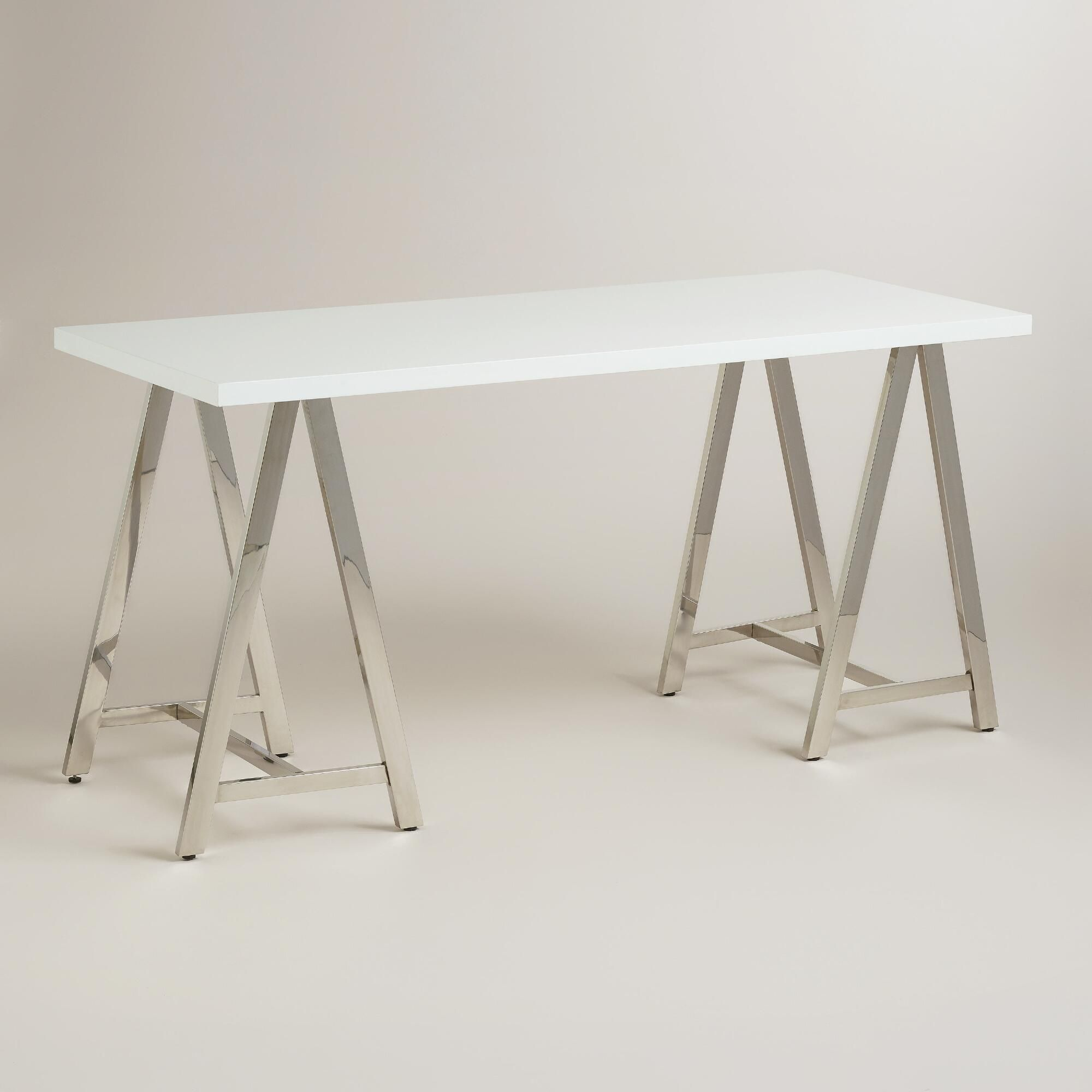 A Sleek High Gloss Lacquer Top And Chrome Sawhorse Base Combine